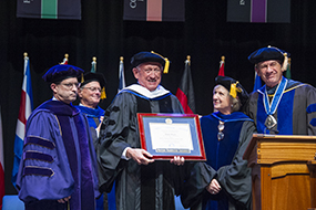 Ralph Munro receives his degree